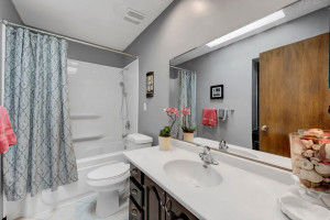 The Full Bath has Updated Colors, Newly Refinished 12-Inch Tile Flooring, Updated Lighting, Faucet and Shower Head and a Deep Circulating Soaking Tub.