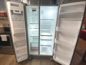 ...and This Side by Side Refrigerator/Freezer with Water and Ice Dispenser.