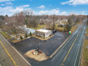 Aerial of Signage and Front/Side Lot of Salon