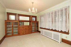 Formal dining features beautiful built in buffet