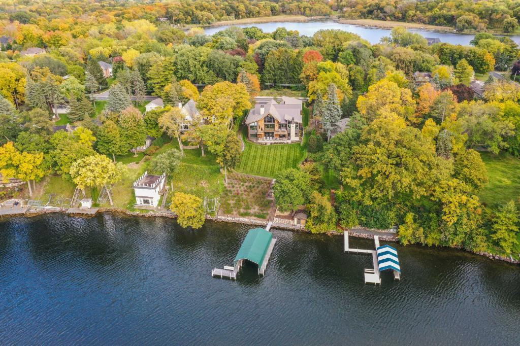 Sited on .77 Acres with 91 ft of prime, sandy shoreline on pristine, A rated Smithtown Bay of Lake Minnetonka