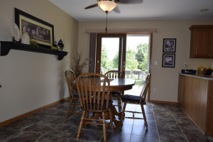 Dining room leads to maintenance free deck.
