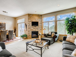 Floor to ceiling gas fireplace with stone surface