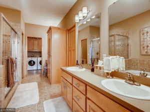 Large master bath with double sinks, jetted tub, ceramic floors, separate ceramic shower, large walk-in closet, and separate make-up desk.The master bath also has access to the laundry room. This is a great floor plan!