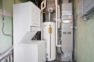 Utility Room with 2 furnaces and washer/dryer