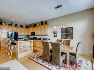 Beautiful kitchen with maple cabinets, maple hardwood floors and breakfast bar with contrasting black granite counter tops. Large formal dining area with access to elevated deck and fantastic views. Great space for entertaining.