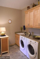 Main floor laundry room which also has access to the master bedroom is sure to please!