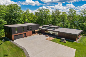 A Corten steel exterior is a fitting tribute to Minnesota's Iron Range workers. Furthermore, this property was completed by Minnesota-based architects and builders.
