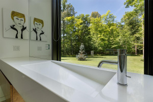Signature Hardware and hidden plumbing, a Mr. Steam Shower and outdoor views in the master bathroom.