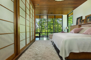 Shoji screen doors accent the closet of this master bedroom with more epic views of the outdoors.