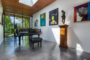 A piano hall separates the main living room and master bedroom.