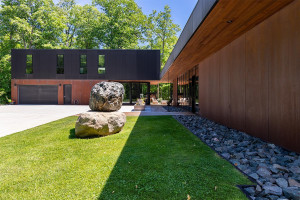 Corten steel has that intentional rusty iron look but is actually weathered to protect the home for generations.