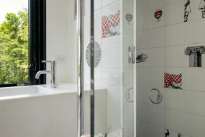 Italian-designed shower tiles and more restoration hardware in guest house.
