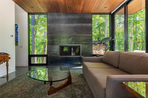 Guest house with Corten steel wood-burning fireplace.