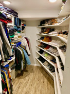 Fantastic walk in closet/pocket door/motion lights