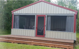 This building is a combination screen porch and storage shed. The screen porch is 12' x 20' and the storage room is 10' x 20'.