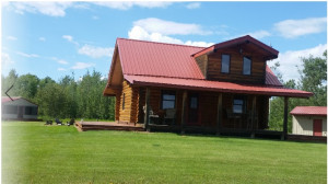 The log home has covered porches on two sides with an open wrap-around deck.