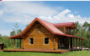 This log home sits on 100 acres and is an ideal hunting and recreation property.