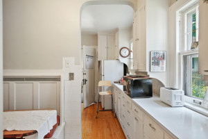 The main floor kitchen is bright with all white cabinets and countertops. 1484 Summit Avenue, St. Paul, MN.