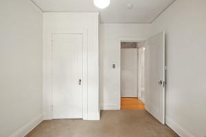 This bedroom features a built in closet. 1484 Summit Avenue, St. Paul, MN.