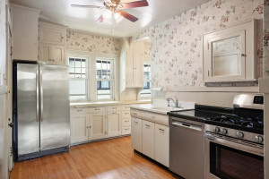 Stainless steel appliances add convenience to this charming kitchen. 1484 Summit Avenue, St. Paul, MN.