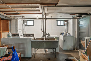 The lower level features a shared laundry space and storage. 1484 Summit Avenue, St. Paul, MN.