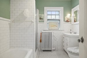 This full bathroom features a separate shower and tub. 1484 Summit Avenue, St. Paul, MN.