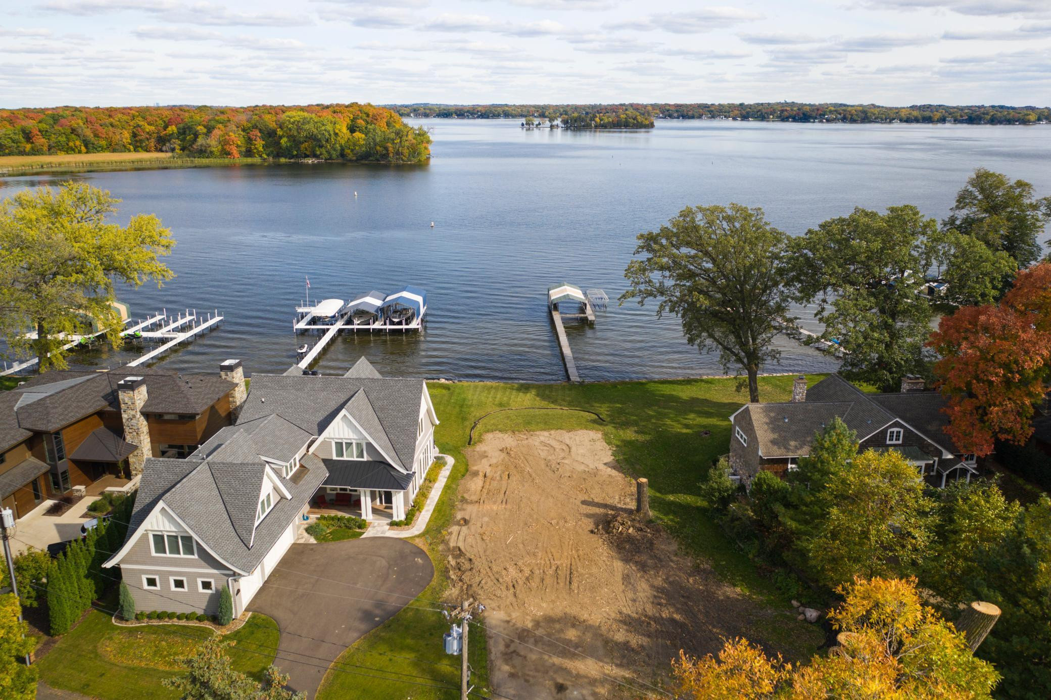Beautiful Opportunity with panoramic Lake Minnetonka views on Echo Bay! Level lakeshore, clear water, and sandy lake bottom.