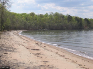 There is nothing like this property on the lake. This 84 acres is close to a major road to bring you to town, w/ lots of restaurants and shopping..yet here on the beach you are totally isolated.