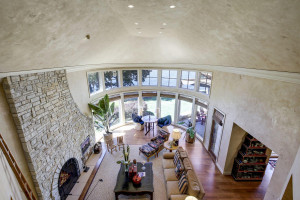 view from the upper level open hallway over looking the living room and lake