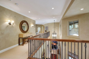 view of the open level hall open to the two story living room