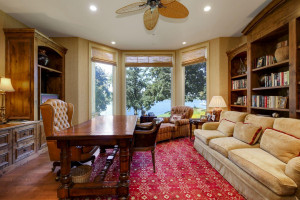 main floor office over looking the water with beautiful floors and built-ins