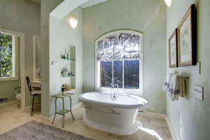 seperate his and hers bath rooms. this is her soaking tub