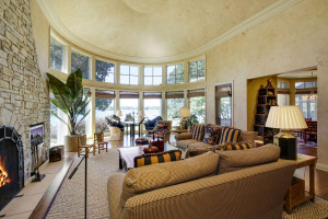 two story living room off kitchen with floor to ceiling windows over looking the water!