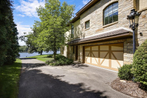 private boat access from your drive way looking from 4th stall garage to lake on side of house.
