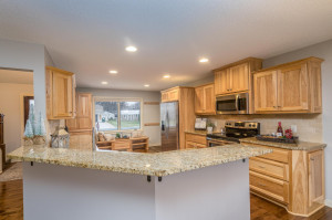 Pull up a stool for informal eating on the granite peninsula overlooking the rich hickory cabinets and granite counter tops.