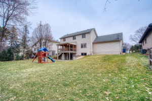 Part of the yard is flat and landscaped making a fun yard for play & entertaining. The rest of the yard is wooded & backs to 18-acre Creekview Park that has Rice Creek running through it.