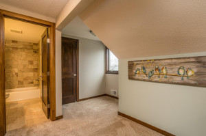 Upper level Loft area is an ideal spot for a homework desk, family library or all-family gaming area. The door in this photo opens to a Very large walk-in closet!