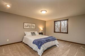 Bedroom 2_Upper Level, overlooks the wooded back yard