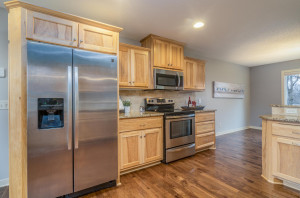 High end touches throughout: stainless steel appliances, custom hickory cabinetry, tumbled Roman tile back-splash and granite counter tops.