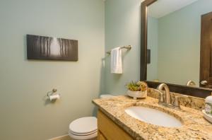 Main Floor Half Bath, updated with granite & ceramic tile