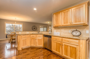 Beautiful granite peninsula & tiled back splash accent the rich hickory cabinets, stainless steel appliances and flush mounted sink.