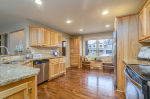 Granite countertops, tumbled Roman tile back splash, custom hickory cabinetry & rich hardwood floors.