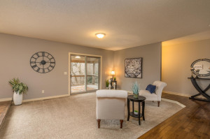 Hardwood floors add warmth to the living room. Step right outside to the covered deck.