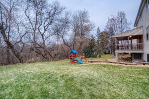 Lot includes a large wooded area. Creekview Park and Rice Creek are beyond the lot line.