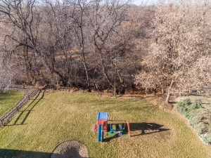 Nice flat backyard surrounded by your woods that open to the city park