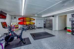 Under the garage is an exercise area, as well as storage space for all your lake toys!