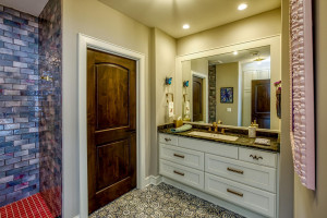 This bathroom is located near the lower level bedrooms