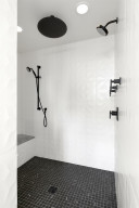 The walk in shower has double shower heads.
