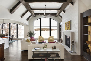 Huge windows in the Great Room take advantage of the long lake views